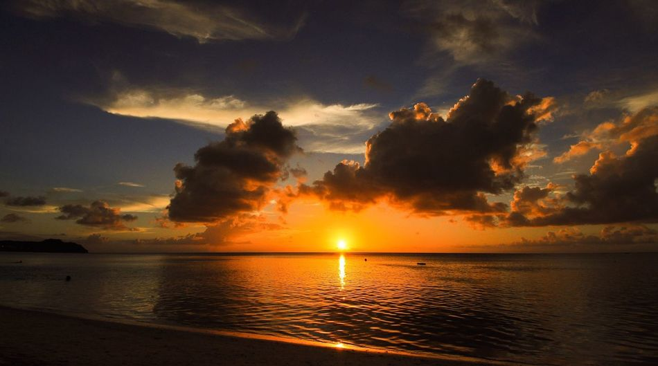 Perspectives On Nature Sunset Sea Beauty In Nature Nature Tranquility Dramatic Sky Idyllic Beach Scenics Tumon Bay, Guam
