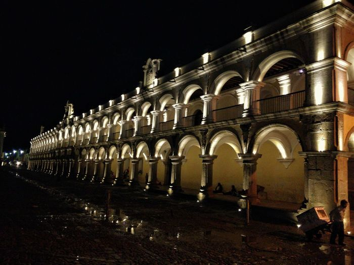 Antigua Guatemala Guatemala View Night Arch Architecture Illuminated Built Structure Outdoors Building Exterior Night Lights Night Photography Arquitecture People Working Hard Street Photography Street Portrait Street Light Guatemala Secrets Outdoors Photography Real People Photography Rainy Season Old Architecture Old Building Exterior Night Shot Walking Around Taking Pictures Walking Alone