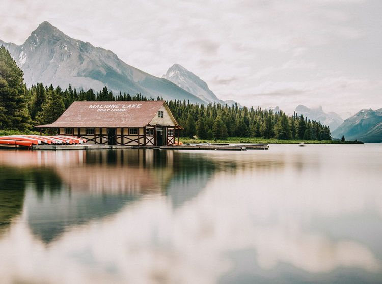 Beauty In Nature Boathouse Canada Cloud - Sky Day Forest Jasper National Park Jaspernationalpark Lake Landscape Maligne Lake Mountain Mountain Range Nature Nautical Vessel No People Outdoors Reflection Scenics Sky Tranquil Scene Tranquility Travel Destinations Tree Water