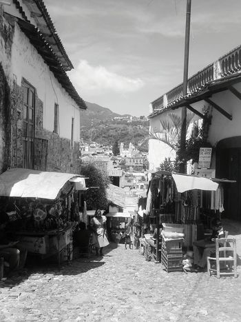 Architecture Building Exterior Built Structure Chair City Cloud Cloud - Sky Day House Incidental People Market Market Stall Mexico Mountain Outdoors Residential Building Residential District Residential Structure Sky Sunlight Table Taxco  Town Village