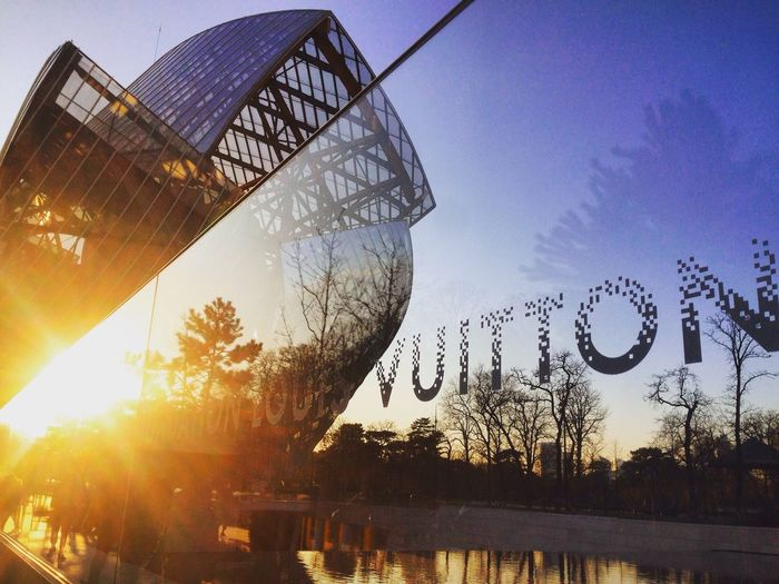 Sun Fondation Louis Vuitton  Moma Exhibited Reflection Outdoors No People Water Built Structure Sunset Sky Day Architecture Nature