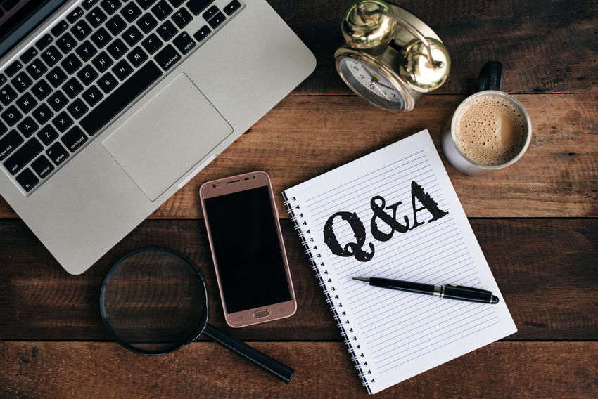 questions and answer concept background Business Coffee Q&A Answer Assist Communication Computer Concept Conceptual Desk Flat Lay Help High Angle View Laptop Magnifying Glass No People Online  Question Questions And Answers Table Technology Top View Web Wireless Technology