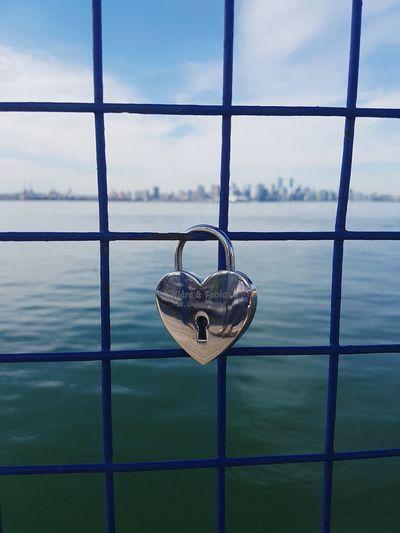 Love Romance Romantic Ocean Urbex Water Sea Window Padlock Cityscape City Sky Close-up Cloud - Sky Locked Gate Chainlink Fence Love Lock Lock Chain Metal Grate Faith Wrought Iron Keyhole Latch EyeEmNewHere The Creative - 2018 EyeEm Awards