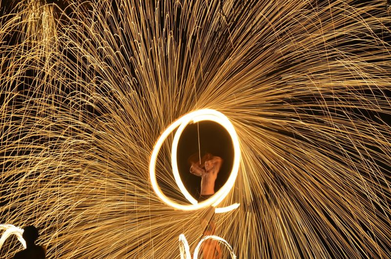 Fire Dancer Spinning Wire Wool At Night
