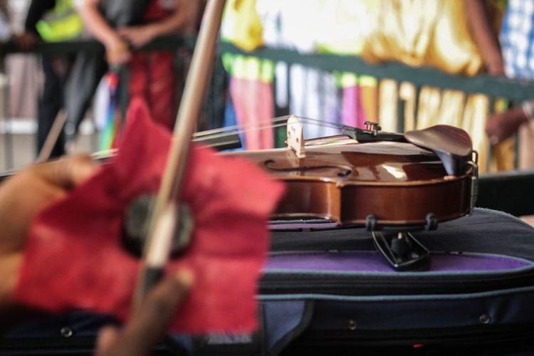 High angle view of violin on luggage