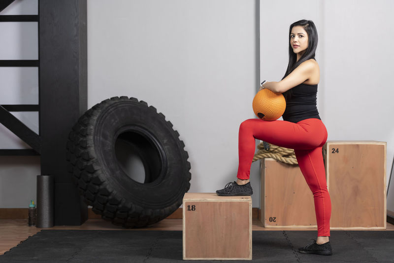 Pregnant Woman Exercising With Medicine Ball At Home