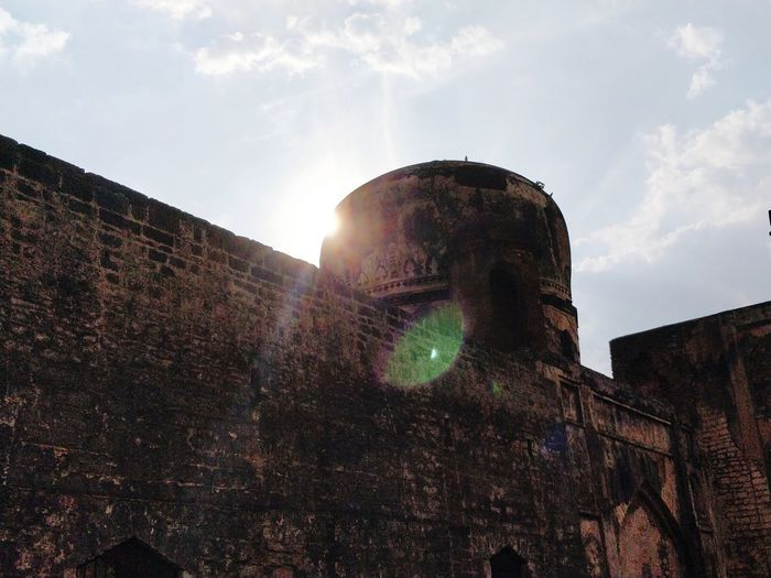 The sun witnessed the ruins, the civilization, the smile, the outcry and then, the silence. Pixelated Lens Flare Sky Architecture Shining Sun Building Multiple Exposure Sunset Optical Illusion Multi-layered Effect Sunbeam