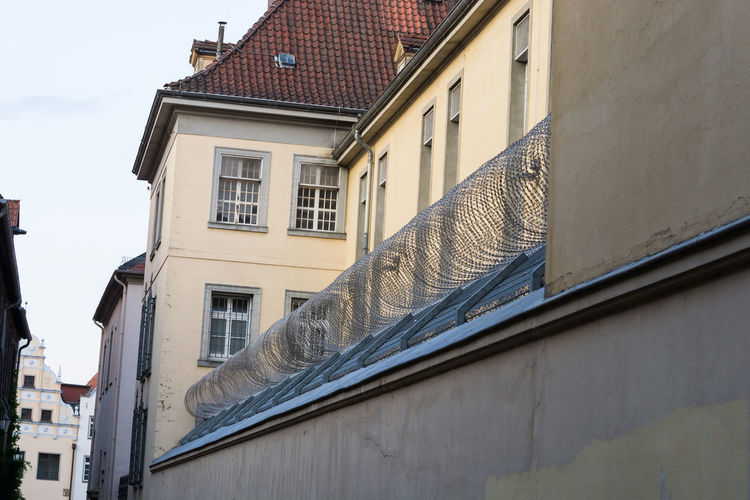 Correctional facility in Lüneburg with barbed wire and guard tower of the prison Building Exterior Built Structure Architecture Building Window Residential District Day No People City Roof House Nature Outdoors Low Angle View Sky Sunlight Town Focus On Foreground Glass - Material Shadow