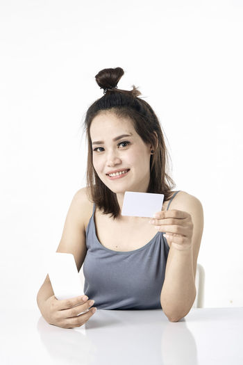 Thai Studio Shot 30-34 Years Shopping Online  Young Female Happy Asian  Laptop Beautiful Internet Attractive Smile person Computer People Portrait Holding Phone Beauty Mobile Pretty Technology Payment Adult Using Lifestyle Cheerful Purchase Business Wireless Lady Chinese Fashion Looking Smartphone Japanese  Korean Credit Card Empty Text Copy Space Looking At Camera One Person White Background Front View Indoors  Happiness Smiling Cut Out Young Adult Young Women Hair Long Hair Emotion Waist Up Hairstyle Teeth Beautiful Woman