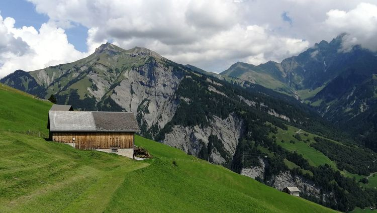 Mountain Agriculture Mountain Rocks Switzerland Alps Switzerland Mountain View Mountain Peak Clouds And Sky Mountains Mountain Cottage Mountain House Green Grass Tree Mountain Rural Scene Sky Architecture Mountain Range Landscape Built Structure Cloud - Sky Green Color