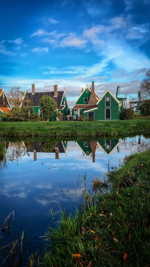 Amsterdam Holland WallpaperForMobile Wallpaper Blue Windmill Cloud - Sky Sky Architecture Built Structure Water Building Exterior Building Reflection House Nature Plant No People Residential District Lake Blue Day Outdoors Beauty In Nature Growth