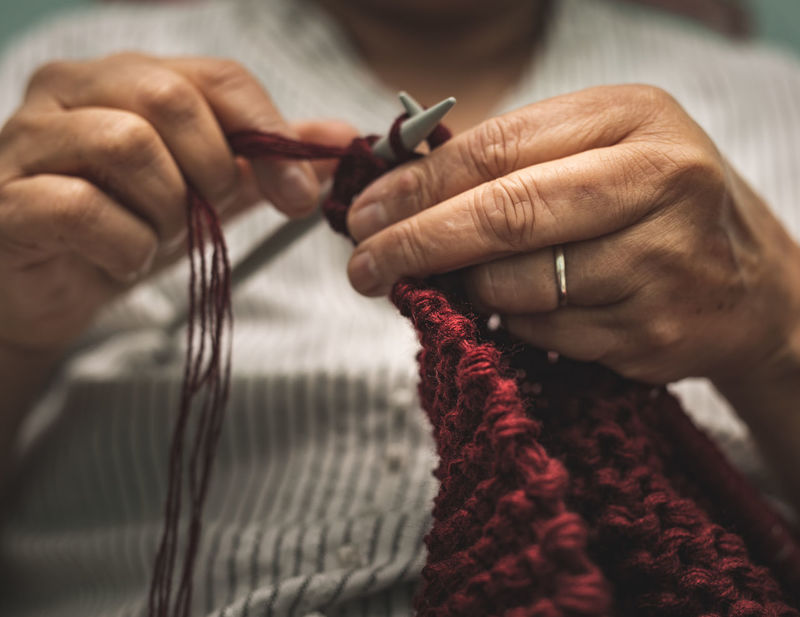 close up of old woman's hands knitting Old Sewing Needle Preparation  Human Finger Focus On Foreground Finger Adult Indoors  Creativity Close-up One Person Skill  Knitting Needle Holding Textile Human Body Part Art And Craft Craft Wool Hand Knitting Human Hand Real People Skill  Indoors  Midsection Selective Focus Preparation