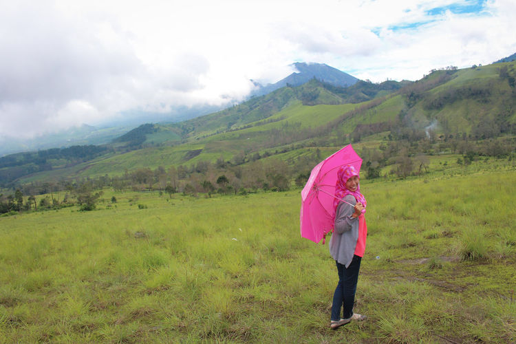 women holding pink umbrella Nature Landscape person People Pink Umbrella EyeEm Mountain Cloud Green INDONESIA One Person Land Landscape Plant Nature Cloud - Sky Beauty In Nature Sky Environment Grass Full Length Women Green Color Field Adult Rural Scene Clothing Day Pink Color Rain