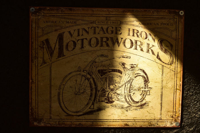 vintage metal motorcycle sign Motorcycle Sign Vintage Style Black Background Close-up Day Metal Sign No People Text