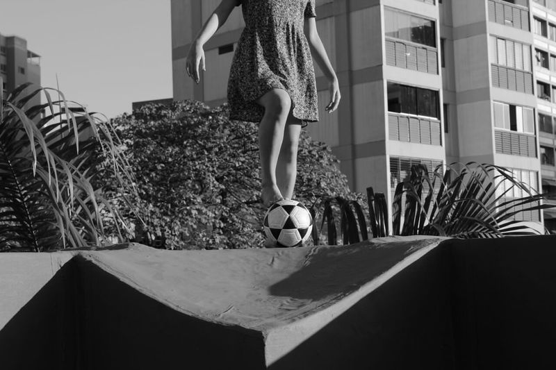 Low section of woman with soccer ball