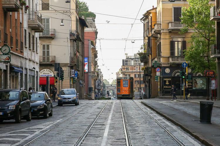 Tram On Road Along Buildings