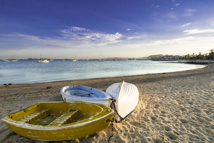 boats on the beach Beach Beauty In Nature Boat Cloud - Sky Day Horizon Over Water Jet Boat Mode Of Transport Moored Nature Nautical Vessel No People Outdoors Rowboat Sand Scenics Sea Sky Tranquility Transportation Water