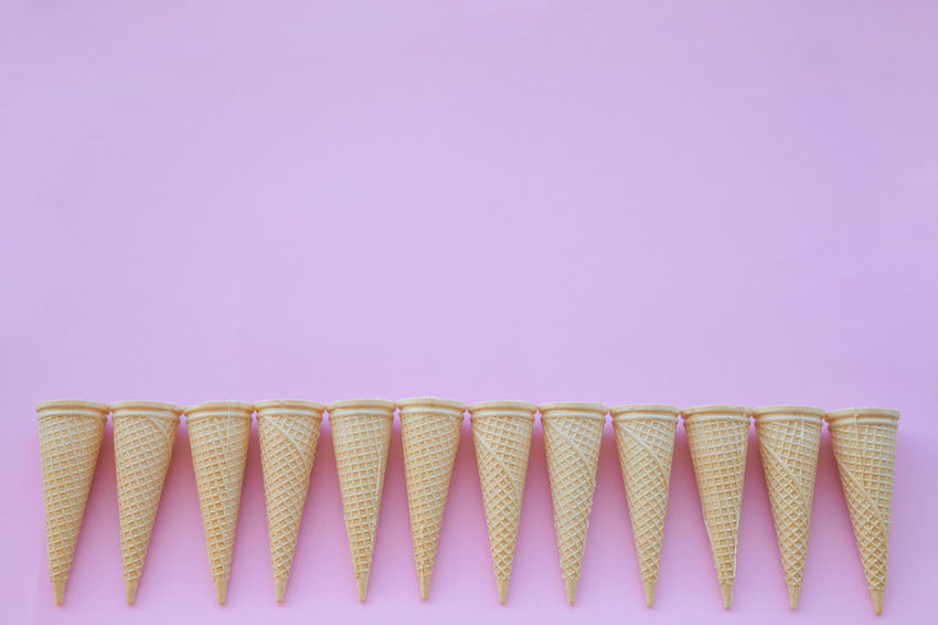 Blue Background Close-up Colored Background Cone Copy Space Cut Out Food And Drink Horn Ice Cream In A Row Indoors  Indulgence Large Group Of Objects No People Order Paper Pastel Colored Pink Background Pink Color Side By Side Snack Studio Shot Sweet Sweet Food Unhealthy Eating