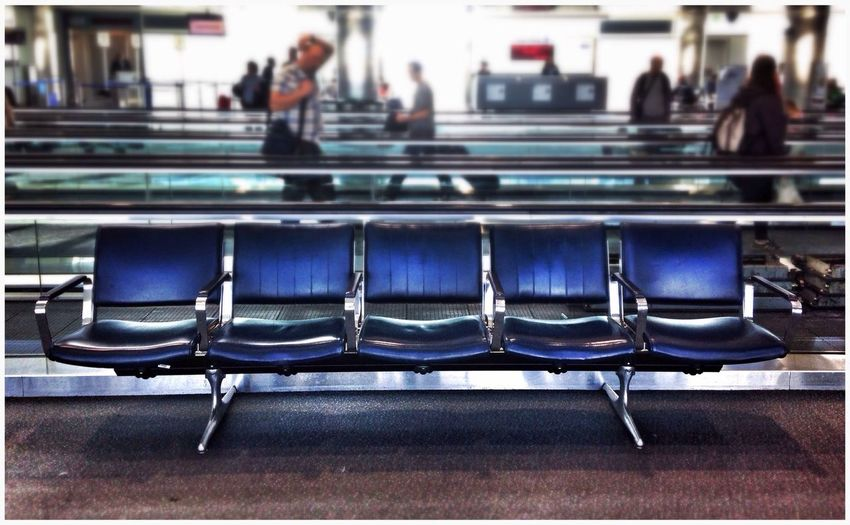 People at waiting area at denver international airport