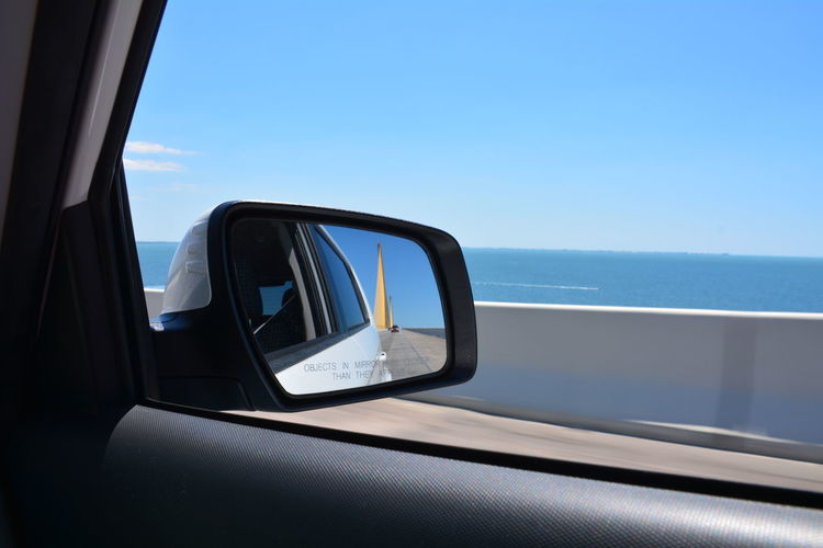 View from the passenger side riding over the Sunshine Skyway Bridge (I-275) Tampa Bay area Florida Transportation Horizon Over Water Window Sky No People Vehicle Interior Clear Sky Scenics Day Sunshine Skyway Bridge Passenger View Passenger Side View Side View Mirror Roadtrip Tampa Bay Blue Blue Sky Water Over The Bridge Bridge - Man Made Structure Vehicle Mirror Side-view Mirror Highway