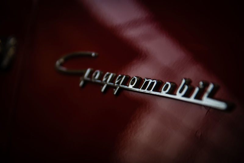 Goggomobil Goggomobil Indoors  Studio Shot Text Western Script No People Close-up Communication Single Object Colored Background Red Single Word Simplicity Emotion Music Selective Focus Arts Culture And Entertainment Dark Wood - Material Night