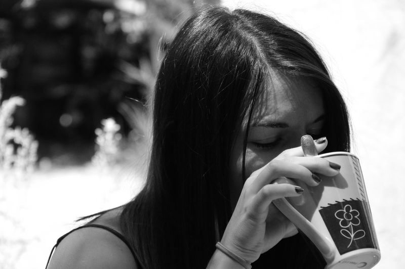 Close-up portrait of a girl drinking coffee