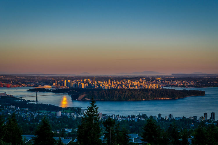 Beauty In Nature Blue City Cityscape Idyllic Illuminated Landscape Mountain Nature No People Orange Color Outdoors Residential District Scenics Sky Standing Water Sun Sunset Tranquil Scene Tranquility Vancouver Water