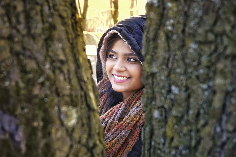 hiding beauty Smiling Portrait Wool Adult One Woman Only Happiness Tree Trunk Only Women One Person Women Young Women One Young Woman Only Young Adult Headshot Day Human Face