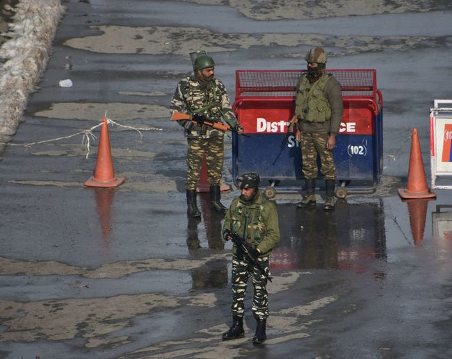 paramilitary soliders stand guard during strike in was observed in Srinagar and other parts of Kashmir valley in connection with the sixth death anniversary of Mohammad Afzal Guru on Saturday Politics And Government Military Army Army Soldier Men Uniform War Military Uniform Armed Forces