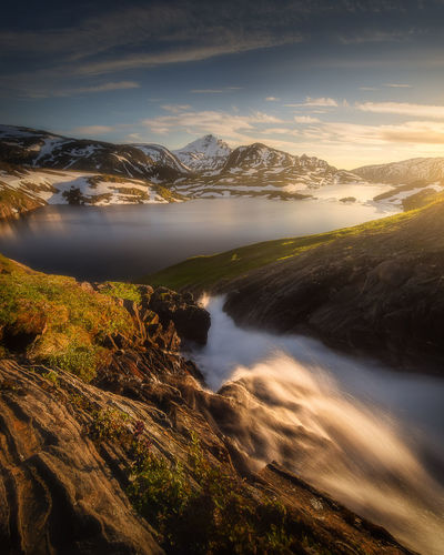 Beauty In Nature Scenics - Nature Mountain Water Cloud - Sky Non-urban Scene Environment Outdoors Mountain Range Nature Rock Sunset Landscape River Norway Norway🇳🇴 Lake Midnight Sun Long Exposure EyeEm Best Shots EyeEm Nature Lover Nature Landscape_photography Lake View Adventure