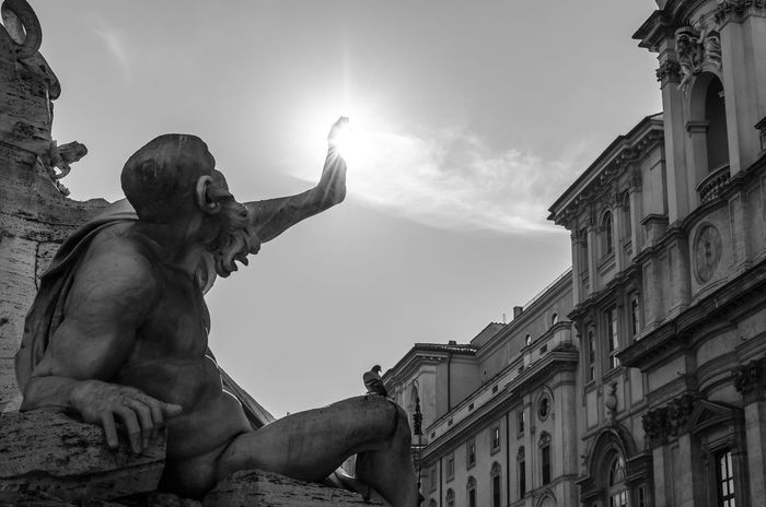 Piazza Navona Piazza Navona, Rome Italy Rome Architecture Art And Craft Blackandwhite Building Exterior Built Structure Day Gargoyle Human Representation Low Angle View Male Likeness No People Outdoors Sculpture Sky Statue Black And White Friday The Street Photographer - 2018 EyeEm Awards The Architect - 2018 EyeEm Awards #urbanana: The Urban Playground Capture Tomorrow