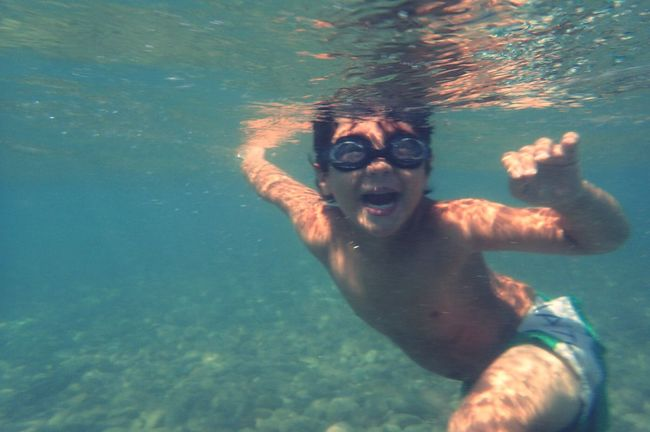 Underwater Water Real People Leisure Activity One Person Swimming Lifestyles Looking At Camera Fun Vacations Sea Childhood Elementary Age UnderSea