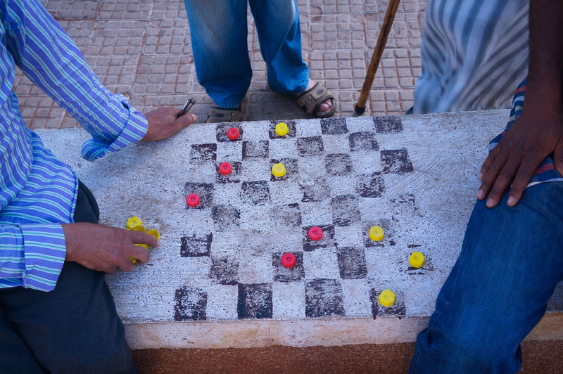 Street Playas 🤓🤡 Go Game Mini Go Game Chess Derivatives Board Game Board Games Abstract Strategy Game Killing Time Human Body Part Low Section Human Leg Togetherness Human Hand In The Park Chess Board Chess Piece Strategy Tactics Tactics Board Read Ahead Opponent Streetphotography