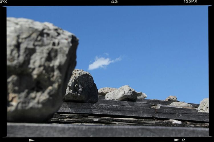 Rocks against blue sky