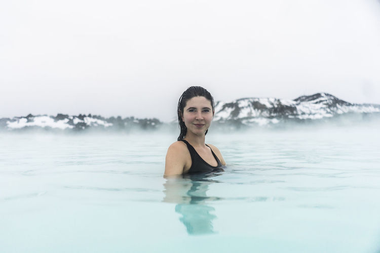 Blue Lagoon Beautiful People Beautiful Woman Beauty Bikini Cheerful Day Happiness Leisure Activity Looking At Camera Nature One Person One Woman Only One Young Woman Only Outdoors Portrait Relaxation Sky Smiling Swimming Vacations Water Waterfront Young Adult Young Women