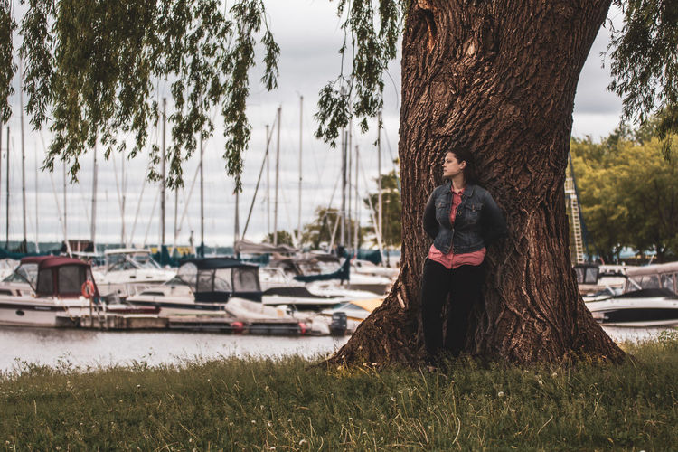 Portrait of a woman Portrait Of A Woman Tree Adult Casual Clothing Day Leisure Activity Lifestyles Mode Of Transportation Nature Nautical Vessel One Person Outdoors Plant Port Portrait Portrait Photography Real People Sitting Sony A68 Tamron 70-200mm F/2.8 Transportation Tree Tree Trunk Trunk Water Women Young Adult The Portraitist - 2018 EyeEm Awards