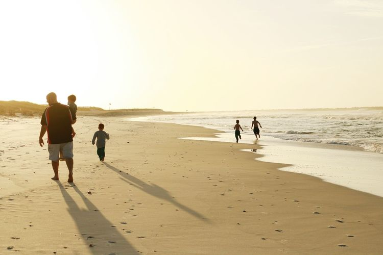 Showcase: January Life Is A Beach Walking On The Beach Father And Sons Family EyeEm Nature Lover EyeEm Best Shots Popular Silhouette Light And Shadow Water_collection Waterscapes Kids Running On Beach Sunrise_Collection Sunrise Silhouette People Walking Around Learn & Shoot: Layering Beauty Redefined Preserving Memories Life In Motion Eye4photography  Landscapes With WhiteWall People Together Fatherhood Moments