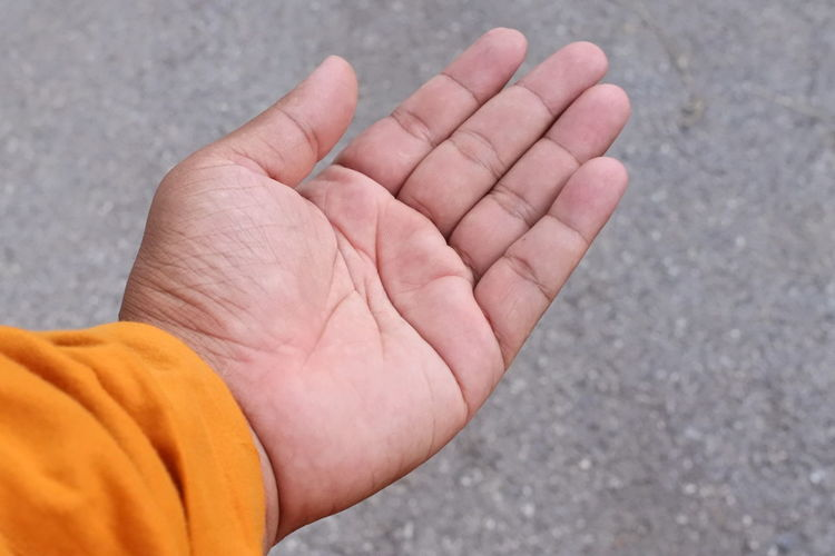 Cropped hand of person on street