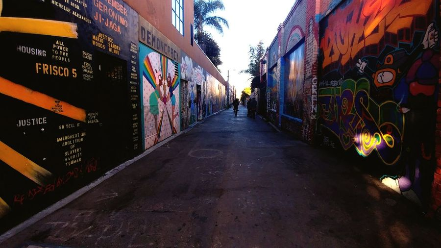 City Graffiti Architecture Building Exterior Built Structure Sky Alley vanishing point Lane Passageway Aged Destinations Passage Path Narrow Empty Road Pathway