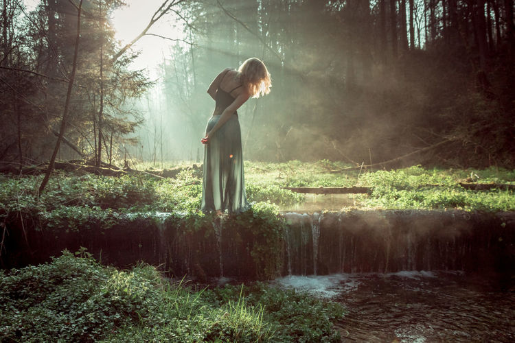 Magical Forest Adult Canon EyeEmNewHere Fantasy Fog Forest Grass Magical Mood Morning Light Mystique Nature One Person One Woman Only Outdoors Selfportrait Solitude Sunlight Tree Water Women WoodLand