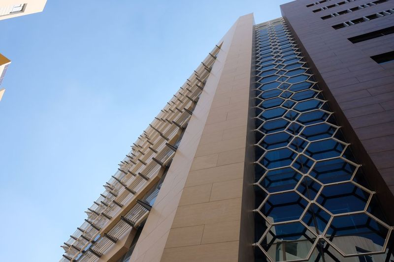Serviced apartment Real Estate Qatar Apartment Doha Architecture Built Structure Low Angle View Building Exterior Sky Building Day Clear Sky No People Nature Pattern Office Building Exterior Tall - High Skyscraper Blue City Travel Destinations Modern Tourism Sunlight