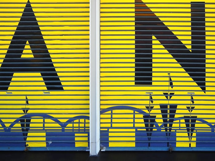 Closed yellow shutters on shop
