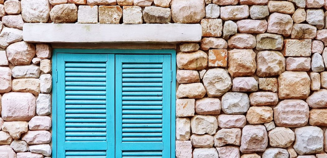 Light green vintage window Built Structure Architecture Building Exterior Closed Wall Stone Wall Door Wall - Building Feature Protection Entrance Security Pattern Backgrounds Solid Textured  Building House Window Brick Turquoise Colored Vintage Rock - Object Design Surface EyeEmNewHere