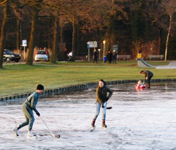 Fun On The Ice Ice Hockey Fast Sport Wintertime Frozen Lake Grass Park Warande Helmond Leisure Activity Sport People