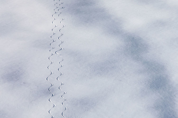 Italy Südtirol No People Day Nature White Color Outdoors Snow Traces Traces In The Snow Skiing Adventure Ski Touring Powder Snow Ski Trail Metal In A Row Pattern Close-up Backgrounds Low Angle View Sky Full Frame Repetition Gray Textured  Connection