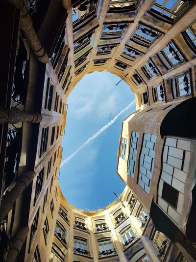 Low angle view. courtyard of a building against sky
