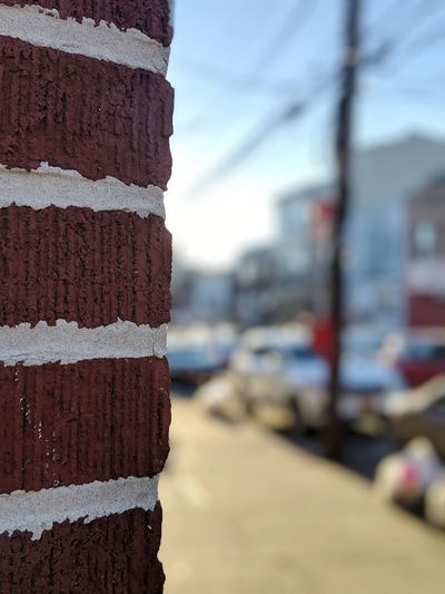 Close-up of stack against wall