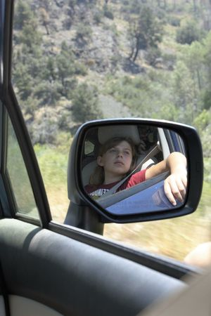 Girl's reflection from the side mirror on a road trip Car Ride  Child Leisure Activity National Park Reflection Road Trip Scenic View Transportation
