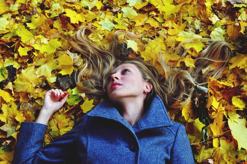 Blonde woman in yellow maple leaves Autumn Yellow Leaf Adult Outdoors Young Adult Women Young Women Nature Mix Yourself A Good Time Fall Autumn Long Hair Enjoyment Relaxation The Week On EyeEm