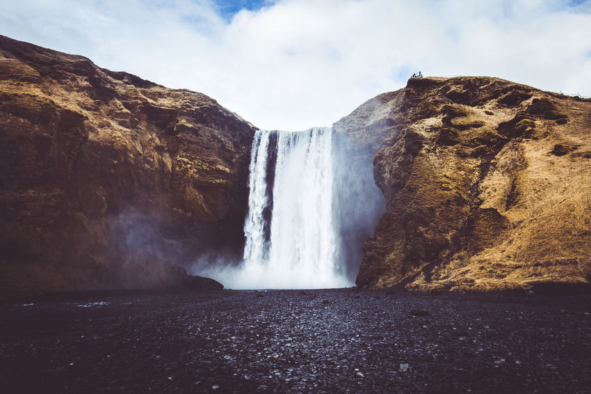 Days of travel: 6 - Skogafoss is one of the biggest waterfalls in Iceland, with a drop of 60 meters and a width of 25 meters. The falls come directly from two glaciers, Eyjafjallajokull and Myrdalsjokull. According to legend, the first Viking settler in the area, named Þrasi, buried a treasure in a cave behind the falls. Many have tried to find the chest of gold and a young man almost succeeded, grasping the ring on the side of the chest before it disappeared again. To the great Skógafoss, custodian of the secret of Þrasi, is also attributed a magical power: it is said that whoever gets wet in its waters can find a long sought object once lost. Iceland Nature Photography Beauty In Nature Blurred Motion Cloud - Sky Day Environment Falling Water Flowing Flowing Water Iceland_collection Long Exposure Nature Nature_collection No People Outdoors Power Power In Nature Rock Rock - Object Scenics - Nature Sky Water Waterfall Waterfalls The Traveler - 2018 EyeEm Awards The Great Outdoors - 2018 EyeEm Awards
